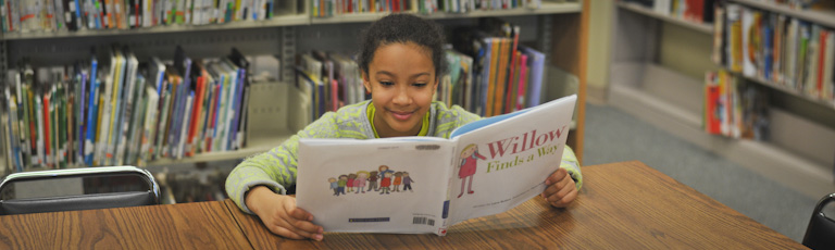 "A young girl reads ""Willow Finds a Way"""